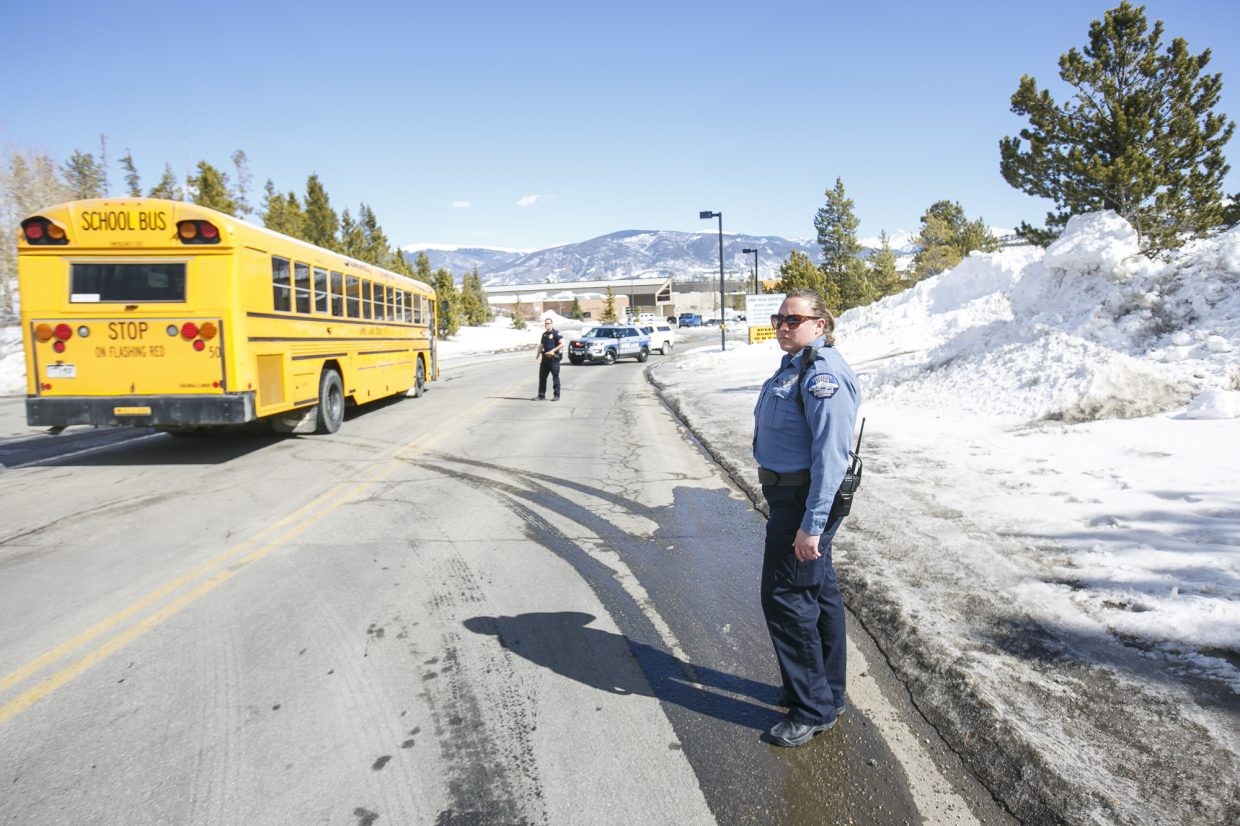 A school bus enters the Summit Middle School to pick up the students following a threat Friday, March 2, in Frisco.