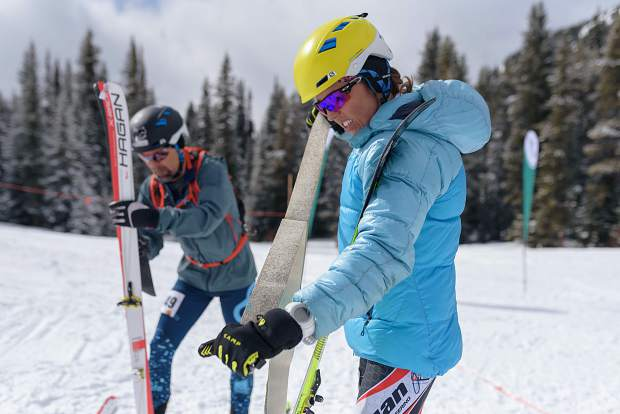 Breckenridge resident Sierra Anderson transitions during last weekend's Pan-American Ski Mountaineering Championships at Lake Louise, Alberta, Canada, Dillon resident and U.S. ski-mountaineer racer Ram Mikulas visible at rear.