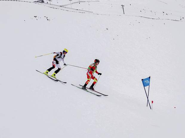 Breckenridge resident Sierra Anderson sets up to pass Lori Anne Donald of Canada on the descent of the final sprint race at the Pan-American Ski Mountaineering Championships in Lake Louise, Alberta, Canada.