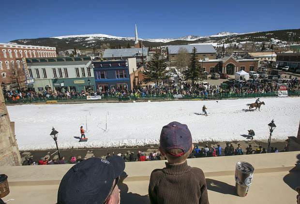 People watch the 70th annual skijoring competition Saturday, March 3, on Main Street in Leadville.