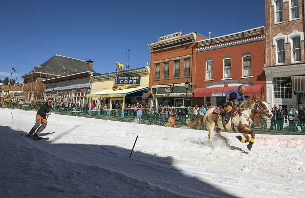 A horse and rider pull a skier through Main Street during the 70th annual skijoring competition Saturday, March 3, on Main Street in Leadville.