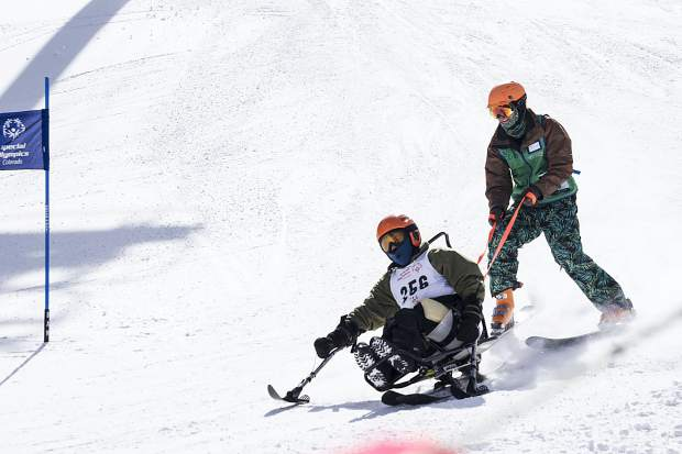A Special Olympics Colorado Winter Games Alpine skiing competitor makes a turn using his bi-ski setup during the Feb. 24-25 event at Copper Mountain Resort.