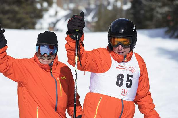 A Special Olympics Colorado Winter Games ski competitor and a volunteer give a thumbs-up to the crowd at the Feb. 24-25 event at Copper Mountain Resort.