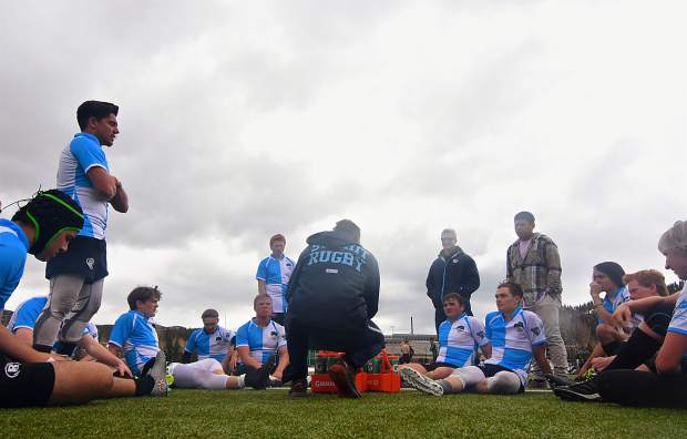 A scene from the 2017 Summit Renegades rugby season, last year's head coach Peter Clarke (center, facing away) talks with his team during halftime of a home game against Grand Valley in Breckenridge on April 1, 2017. The Tigers won, 21-0, for the team's second win of the season and first shutout win in program history.