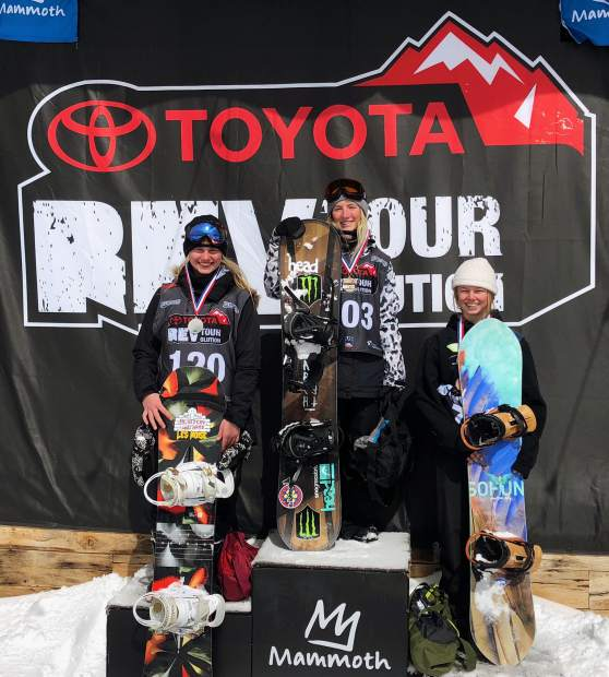 Team Summit snowboarder Ellie Duchow, 16, stands n the podium after she placed third at the Rev Tour big air event at Mammoth Mountain in California on March 14.