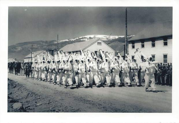 Members of the 10th Mountain Division march on parade at Camp Hale near Pando, Colorado during World War II.