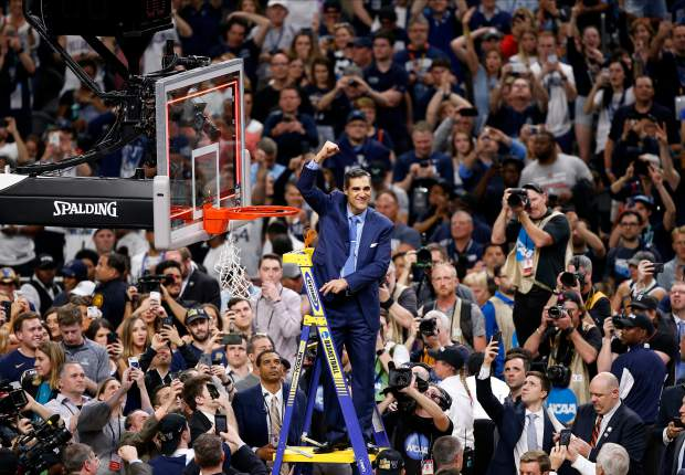 Villanova head coach Jay Wright reacts after cutting down the net after beating Michigan 79-62 in the championship game of the Final Four NCAA college basketball tournament, Monday, April 2, 2018, in San Antonio.