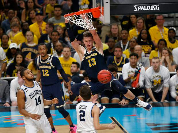 Michigan's Moritz Wagner (13) dunks during the second half in the championship game of the Final Four NCAA college basketball tournament against Villanova, Monday, April 2, 2018, in San Antonio.
