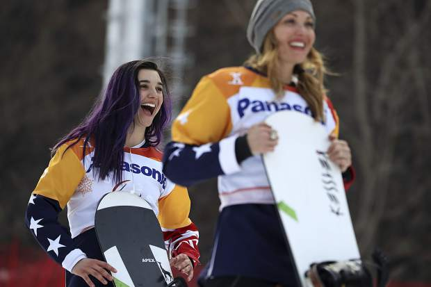 Winners of the Women's Snowboard Cross SB-LL1 event from left include gold medalist Brenna Huckaby of the United States and silver medalist Amy Purdy of the United States. Here they react during a ceremony at the 2018 Winter Paralympics at the Jeongseon Alpine Centre in South Korea, Monday, March 12, 2018.