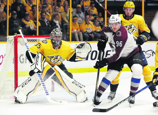 Nashville Predators goalie Pekka Rinne (35), of Finland, guards the net behind Colorado Avalanche right wing Mikko Rantanen (96), of Finland, during the first period in Game 2 of an NHL hockey first-round playoff series on Saturday, April 14, 2018, in Nashville, Tenn.