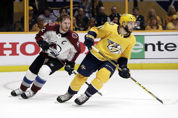 Colorado Avalanche left wing Gabriel Landeskog (92), of Sweden, loses his helmet as he plays against Nashville Predators defenseman Nick Bonino (13) during the first period in Game 1 of an NHL hockey first-round playoff series Thursday, April 12, 2018, in Nashville, Tenn.