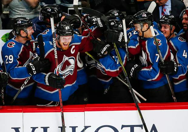 Colorado Avalanche left wing Gabriel Landeskog celebrates with teammates during the third period of an NHL hockey game against the St. Louis Blues on Saturday, April 7, 2018, in Denver. Colorado won 5-2 to advance to the playoffs.