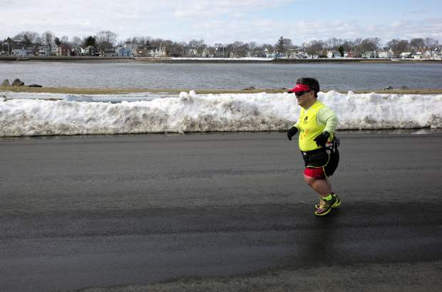 Marathon runner John Young, of Salem, Massachuessets, makes his way along a training route in Salem.