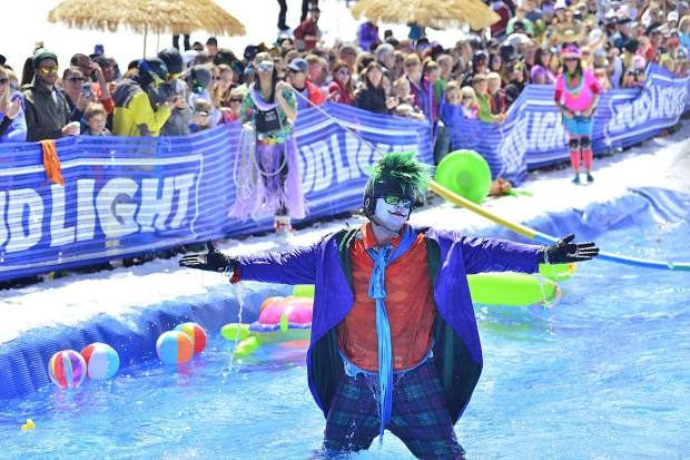 """The Joker"" signals to the crowd after taking the plunge Sunday at Breckenridge Ski Resort."