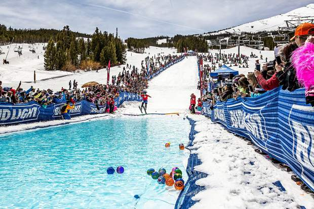 A skier braces for impact with the pond at Peak 8 as part of last year's Breck Plunge. The annual event is a highlight of Breckenridge Ski Resort's closing weekend each season, and will take place this Sunday.