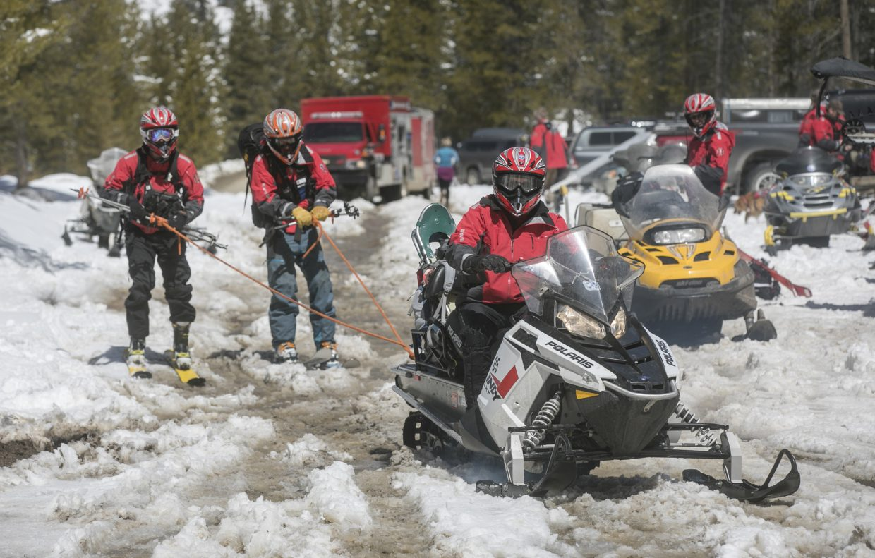 Summit County Search and Rescue team members head out to the the avalanche incident site at Georgia Pass Tuesday, April 10, near Breckenridge.