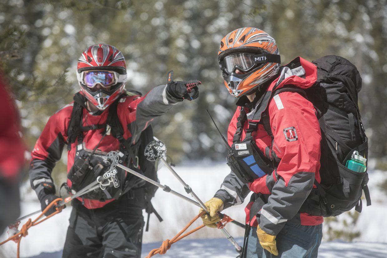 Summit County Search and Rescue's Aaron Parmet, left, and Tyler McGuire prepare to catch a snowmobile ride to the avalanche incident site at Georgia Pass Tuesday, April 10, near Breckenridge.