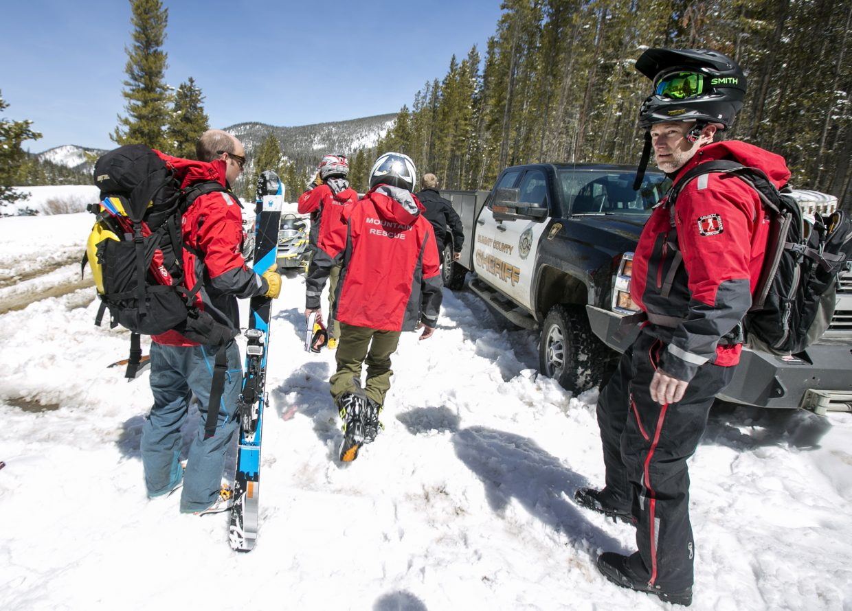 Summit County Search and Rescue mission coordinator Brian Binge, far right, and the team head out to the avalanche incident site at Georgia Pass Tuesday, April 10, near Breckenridge.