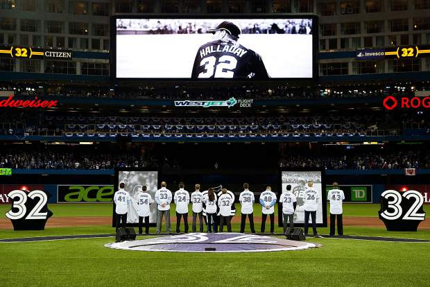 Former Toronto Blue Jays pitcher Roy Halladay is honored at the Blue Jays opening day baseball game against the New York Yankees in Toronto on Thursday, March 29, 2018.