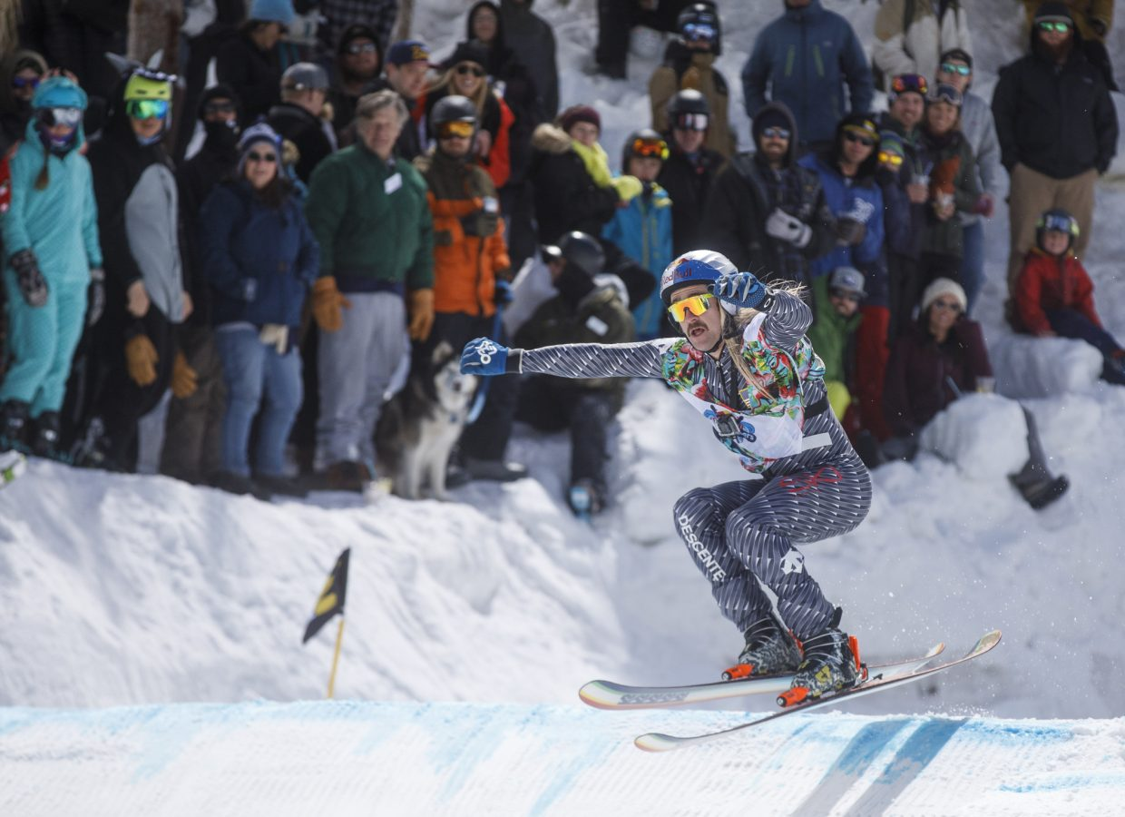 Hayden Wright hits the jump before crashing into the crowds in the Red Bull Slopesoakers Pond Skimming competition Saturday, April 14, at Copper Mountain.