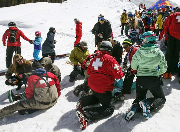 Copper Mountain Ski Patrol assess the injured spectators following the crash at the Red Bull Slopesoakers Pond Skimming competition Saturday, April 14, at Copper Mountain.