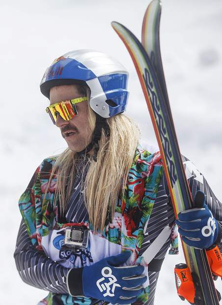Hayden Wright holds his stomach following the crash into the crowds in the Red Bull Slopesoakers Pond Skimming competition Saturday, April 14, at Copper Mountain.