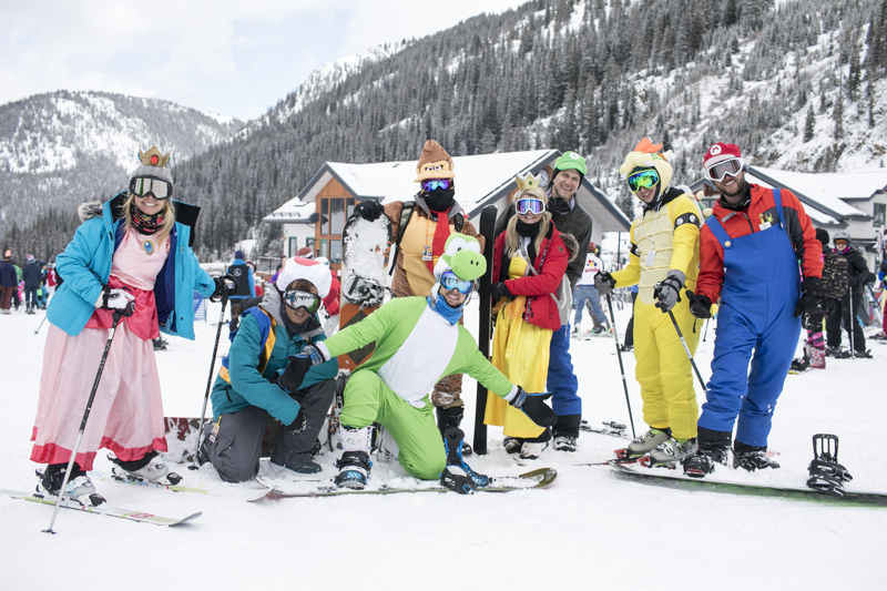 Gapers in video game theme outfits Sunday, April 1, at Arapahoe Basin. The ski resort attract thousands of skiers, snowboarders, and real-life gapers in outfits every year on April Fools.
