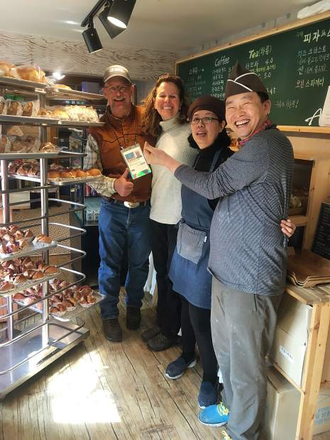 Dillon resident and Copper Mountain Resort winch cat operator Paul Hoagland poses for a photo with new South Korean friends made at the bakery and coffee shop they owned.