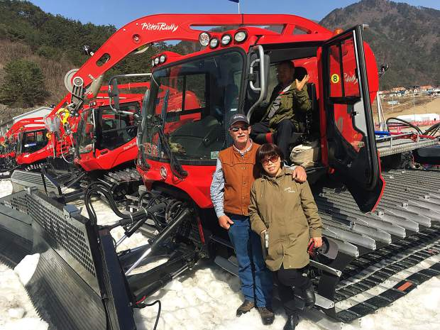 After staying at their lodging establishment for three months, Dillon resident and Copper Mountain Resort winch cat operator Paul Hoagland poses for a photo with new friends in his Olympic winch cat during the Paralympics.