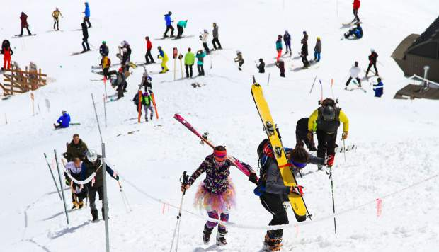 A crowd of Imperial Challenge competitors ascend Breckenridge Ski Resort during the 2017 Imperial Challenge pseudo-triathlon race.