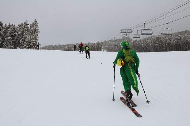 A participant dressed in a dinosaur costume skins up Breckenridge Ski Resort during Saturday's 27th annual Imperial Challenge 'pseduo triathlon' race. The annual race requires participants to either run or bike nearly seven miles to the base of Breckenridge Ski Resort before skinning uphill to the Imperial Express lift before descending via snowboard or downhill ski.