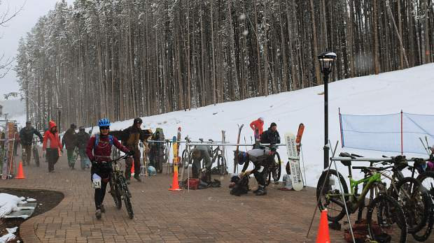 Participants transition from the bike/run portion of the Imperial Challenge race to the uphill skin segment at Breckenridge Ski Resort during Saturday's 27th annual Imperial Challenge 'pseduo triathlon' race. The annual race requires participants to either run or bike nearly seven miles to the base of Breckenridge Ski Resort before skinning uphill to the Imperial Express lift before descending via snowboard or downhill ski.