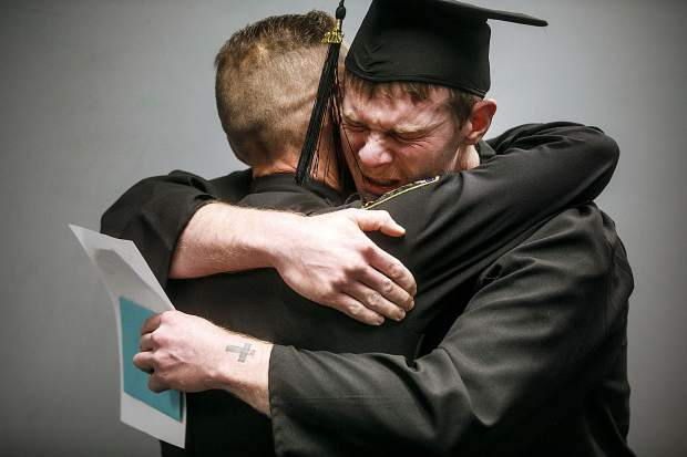 Tyler Little hugs Summit County Sheriff Jaime FitzSimons after learning he was being released from jail early for completing his GED.