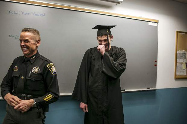 Summit County Sheriff Jaime FitzSimons and Tyler Little share a laugh during a ceremony to honor the inmate for earning his GED.