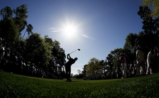 Matt Parziale watches his tee shot on the seventh hole during practice for the Masters golf tournament at Augusta National Golf Club, Monday, April 2, 2018, in Augusta, Ga.