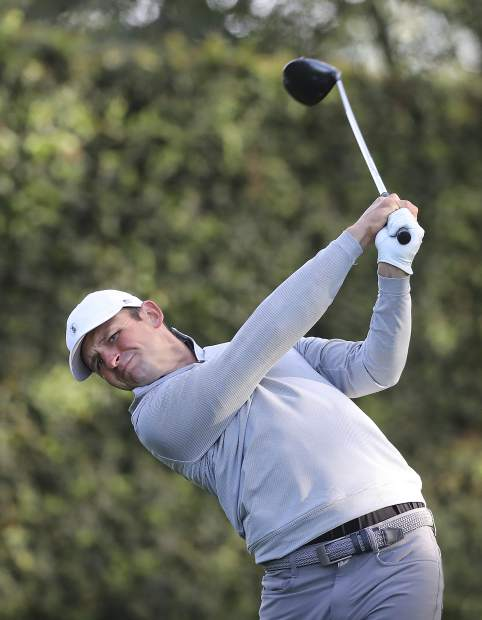 Matt Parziale, the U.S. Mid-Amateur champion who works as a firefighter in his hometown in Massachusetts, tees off on the second hole during a practice round for the Masters golf tournament at Augusta National Golf Club in Augusta, Ga., Monday, April 2, 2018.