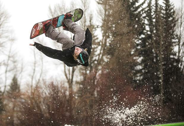 First Friday Rail Jam participant Kevin Sayler does a backflip during the snowboard finals Friday, April 6, at the Silverthorne Performing Arts Center's lawn in Silverthorne.