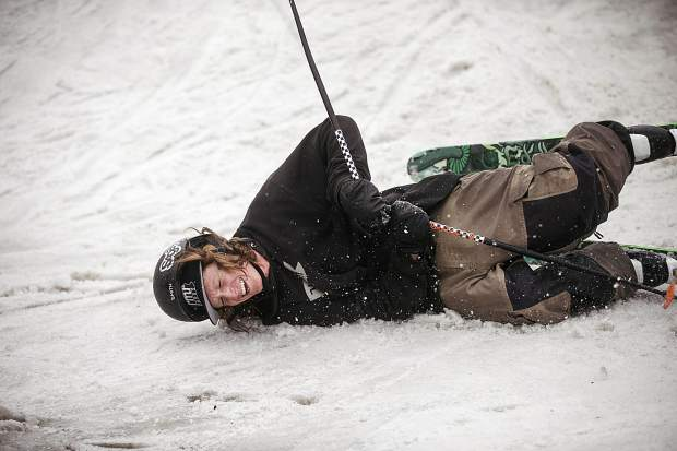First Friday Rail Jam participant laughs after taking a fall from the rail during the finals Friday, April 6, at the Silverthorne Performing Arts Center's lawn in Silverthorne.