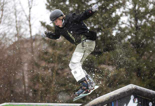 First Friday Rail Jam participant Nate Cordero eyes the rail following a trick in the air during the competition Friday, April 6, at the Silverthorne Performing Arts Center's lawn in Silverthorne.