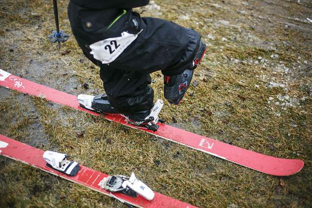 First Friday Rail Jam skier detaches his boots off the skis following a lap Friday, April 6, at the Silverthorne Performing Arts Center's lawn in Silverthorne.
