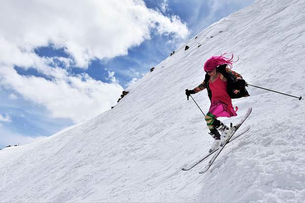 Local extreme skier Jen Smith of Silver Plume gets some electric last turns of the season in Spaulding Bowl at Copper Mountain on Sunday afternoon.