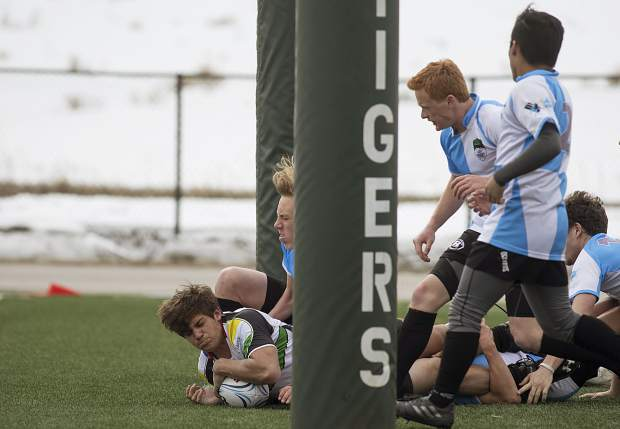 Mountain Vista player reaches the endzone through Summit Renegades rugby players during the home match Saturday, March 31 at the Climax Molybdenum Field at Tiger Stadium. The high school rugby club hosted its first home match for first time in the program's three years.