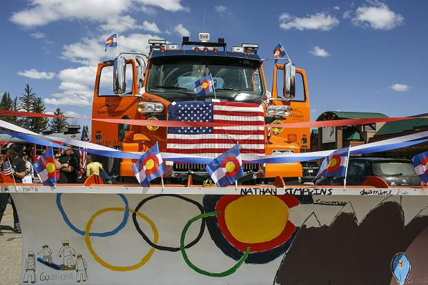 A parade float out of a snowplow truck in spirit to honor the local olympians Saturday, April 28, along Rainbow Drive in Silverthorne.