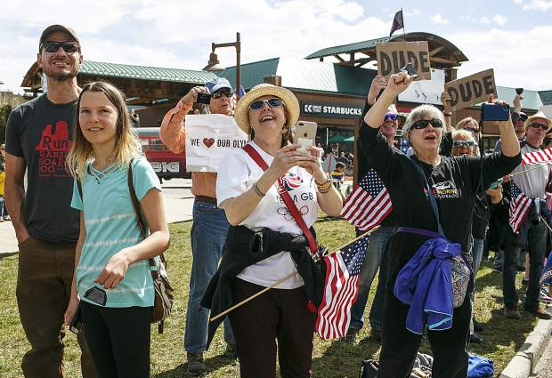Fans cheer on as the local olympians pass through during the parade on Rainbow Drive Saturday, April 28, in Silverthorne.