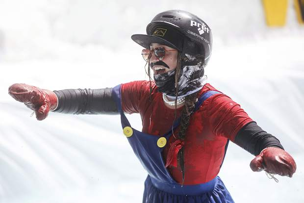 A participant reacts after skiing on the pond in the Red Bull Slopesoakers competition Saturday, April 14, at Copper Mountain.