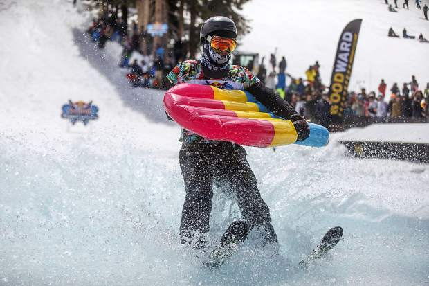 A skier rides on water in the Red Bull Slopesoakers Pond Skimming competition Saturday, April 14, at Copper Mountain.