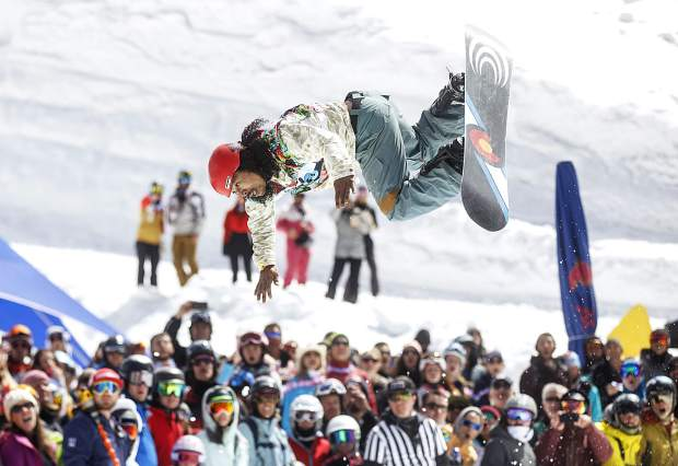 High Country local Seth Karlsrud, who won snowboarder best trick, flips into the water in the Red Bull Slopesoakers pond skimming competition Saturday, April 14 at Copper Mountain Resort. The event is part of the resort's closing weekend celebration, as Copper closes for the season on April 15.