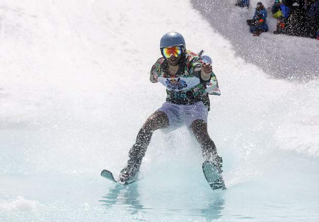 A skier rides on water in the Red Bull Slopesoakers pond skimming competition on Saturday, April 14, at Copper Mountain Resort. The event is part of the resort's closing weekend celebration, as Copper closes for the season on April 15.