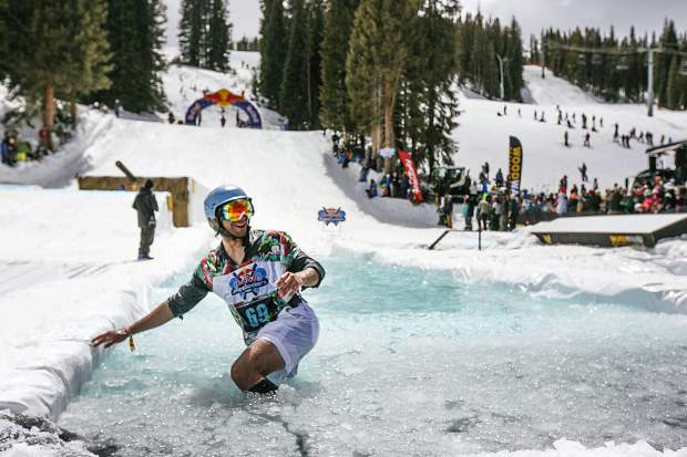 A skier reacts after skiing on the pond in the Red Bull Slopesoakers pond skimming competition on Saturday, April 14 at Copper Mountain Resort. The event is part of the resort's closing weekend celebration, as Copper closes for the season on April 15.