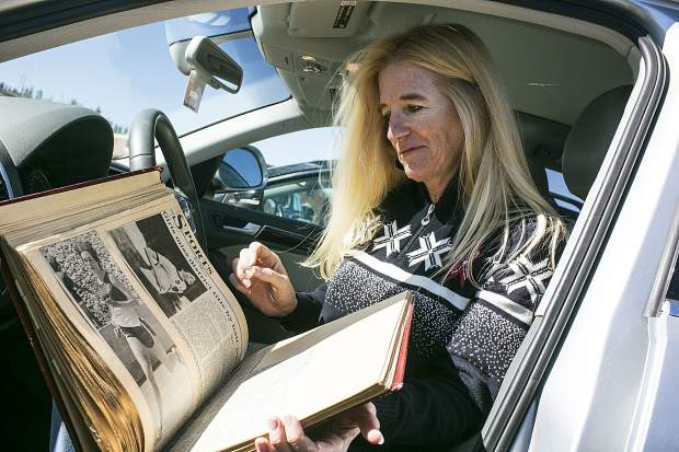 Signe Rockne Stimson looks through old newspaper clippings of her high school days Wednesday, April 25, in Breckenridge.